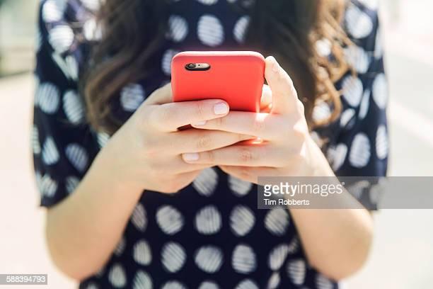 Woman using a smart phone, close up.