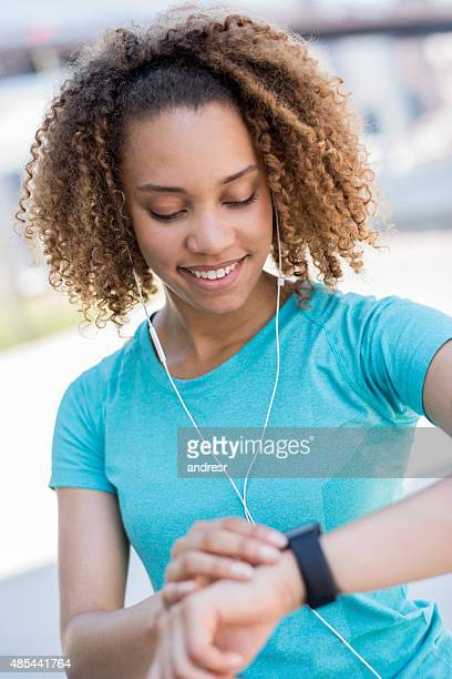 Woman using a smart watch to track workout progress