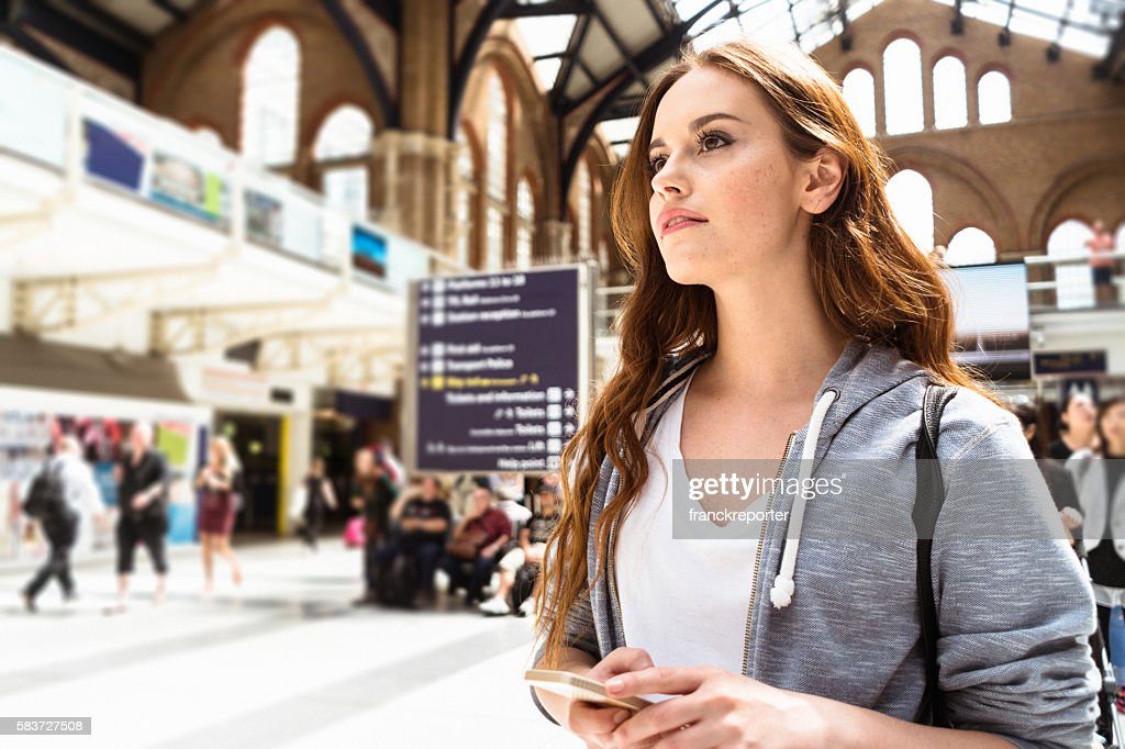 woman using a smartphone on liverpool street : Stock-Foto