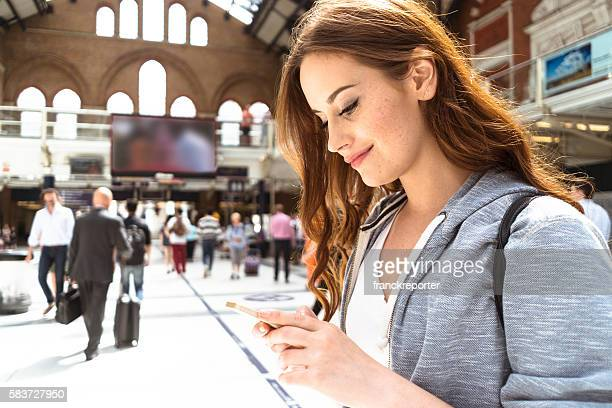 woman using a smartphone on liverpool street