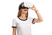 Woman using a virtual reality headset isolated on white background