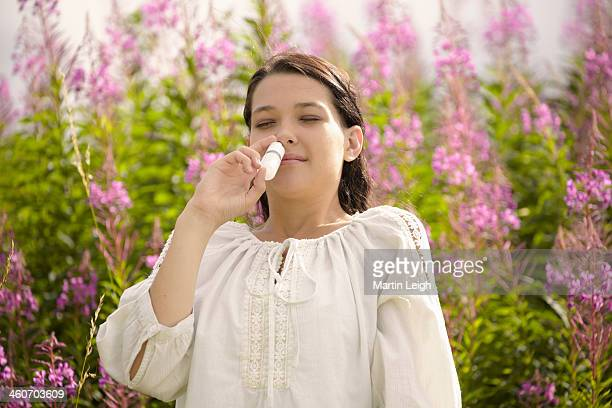 Woman using allergy relief nasal spray