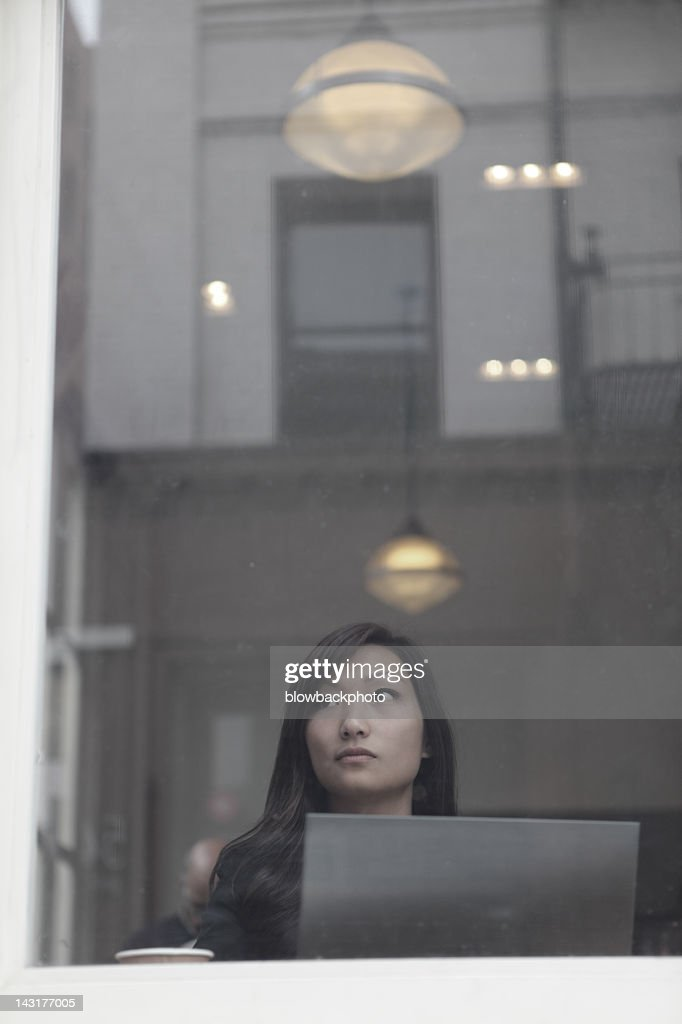 Woman Using an Ultrabook in a Coffee Shop : Stock Photo