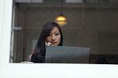 Woman Using an Ultrabook in a Coffee Shop