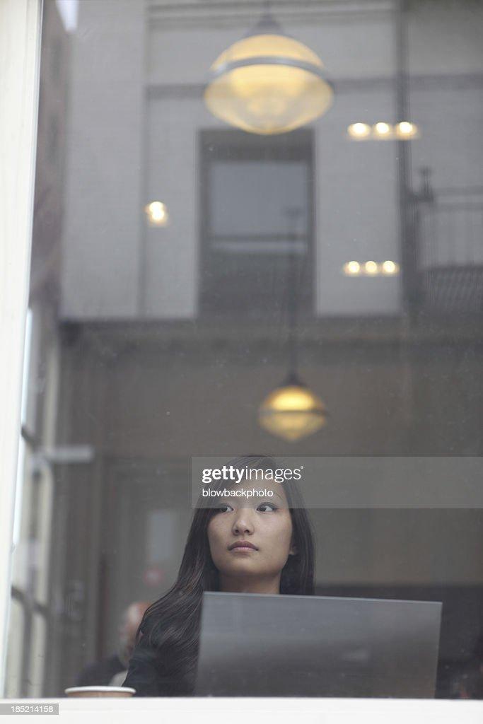 Woman Using an Ultrabook Laptop