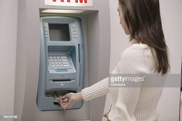 Woman using ATM machine