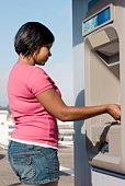 Woman using ATM, Santa Cruz, California