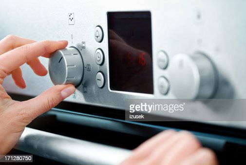 Woman using baking-oven