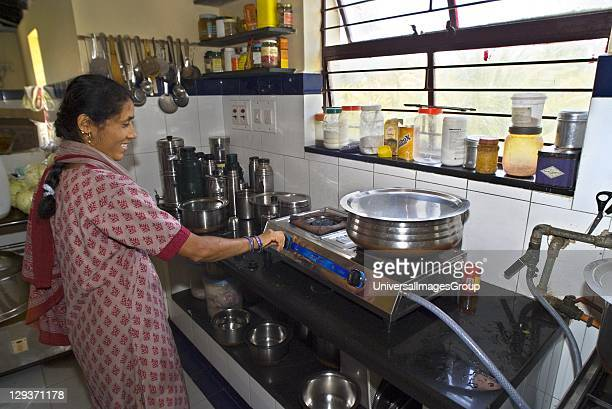 Woman using biogas cooker