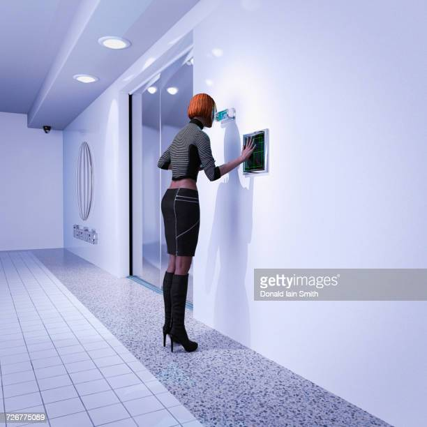 Woman using biometric scanners in futuristic corridor