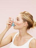 woman using blue inhaler