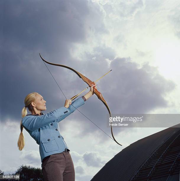 Woman Using Bow and Arrow