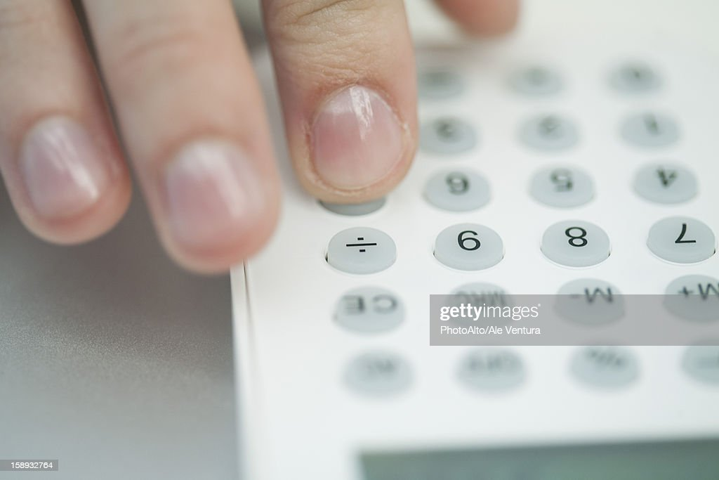 Woman using calculator, extreme close-up : Stock Photo