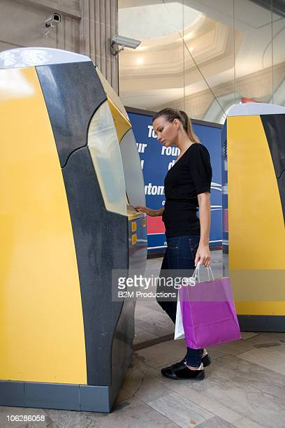 Woman using cashpoint