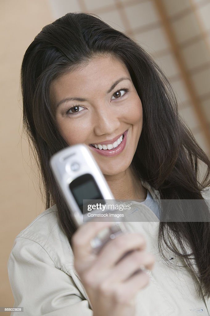 Woman using cell phone : Stock Photo