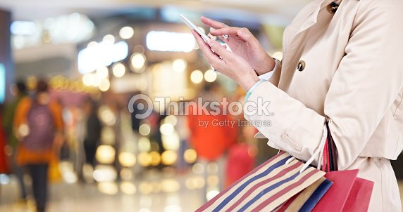 woman using cellphone while shopping : Stock Photo