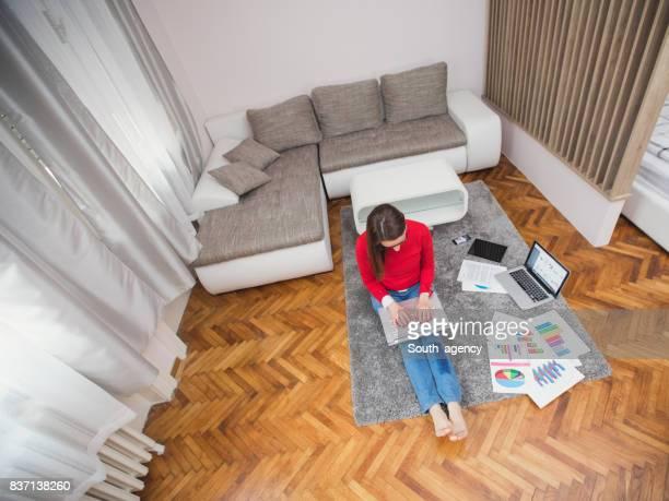 Woman using computer at home