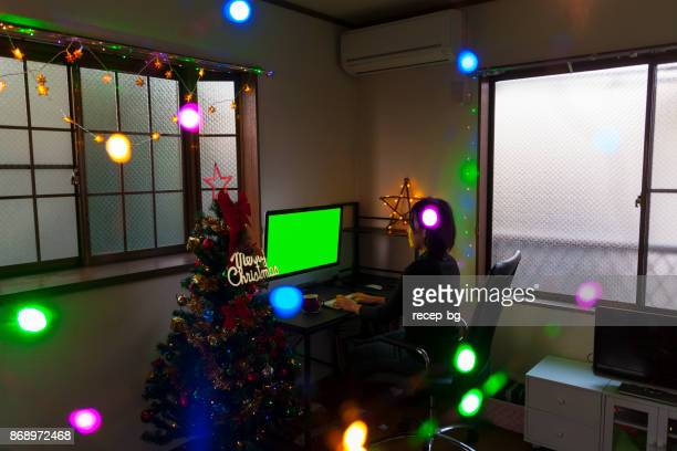 Woman Using Computer During Christmas