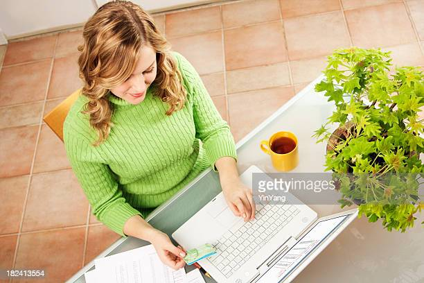 Woman Using Computer Internet Electronic Banking, Paying Credit Card Bill