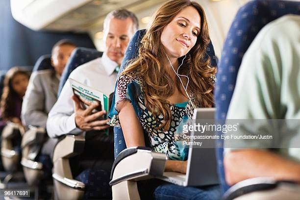 woman using computer on airplane