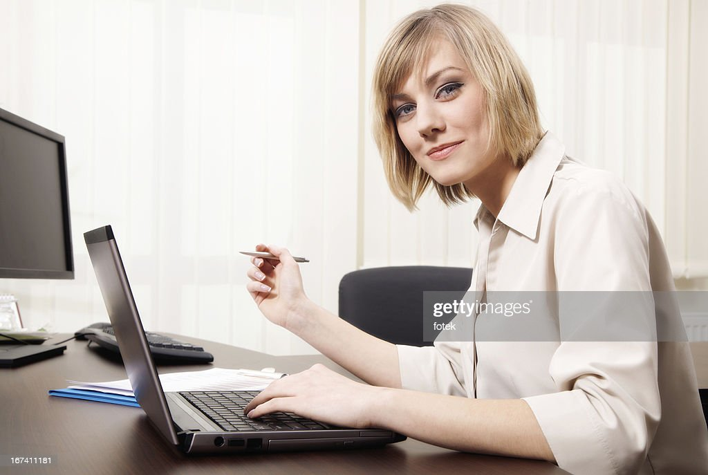 Woman using computer : Stockfoto