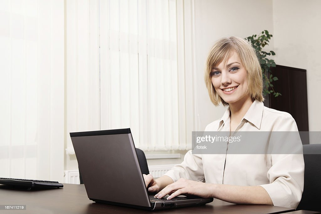Woman using computer : Stockfoto