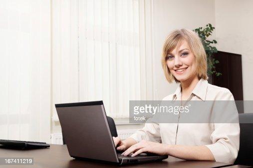 Woman using computer : Stock Photo