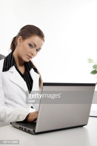 Woman using computer : Stock Photo