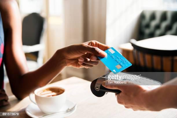 Woman using contactless payment, close up