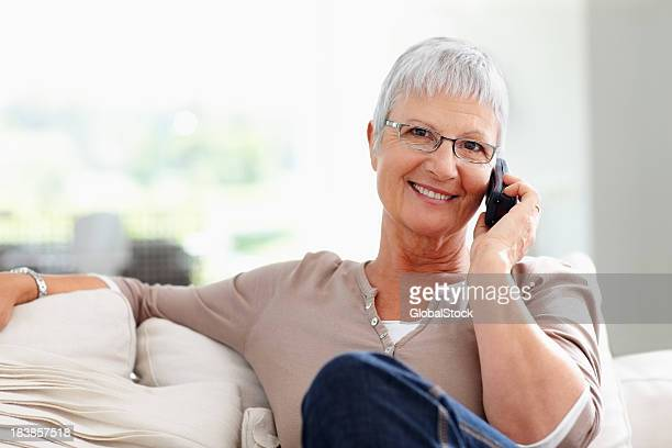 Woman using cordless phone