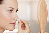 Woman Using Cotton Swab Around Eye