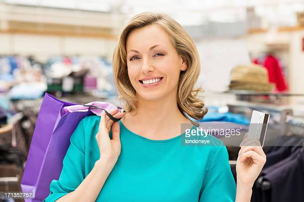 Woman Using Credit Card For Shopping