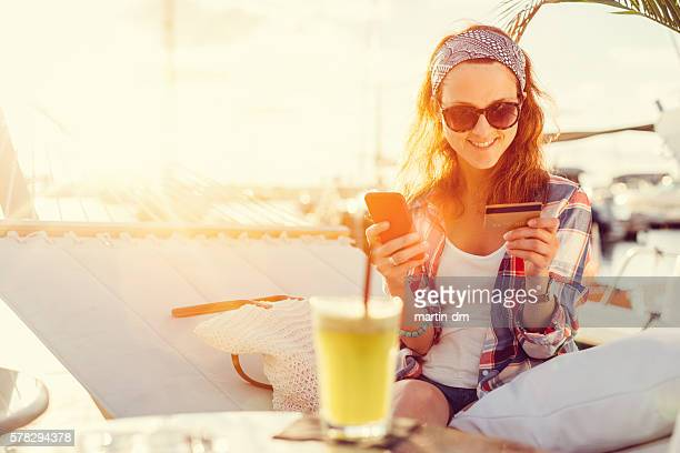 Woman using credit card on a vacation