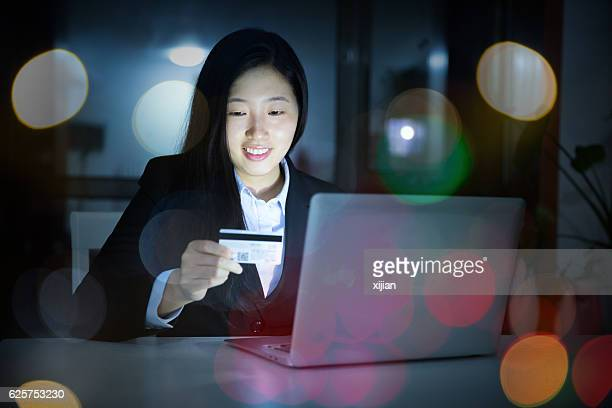 Woman using credit card shopping