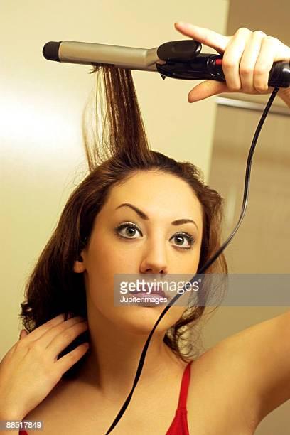 Woman using curling iron