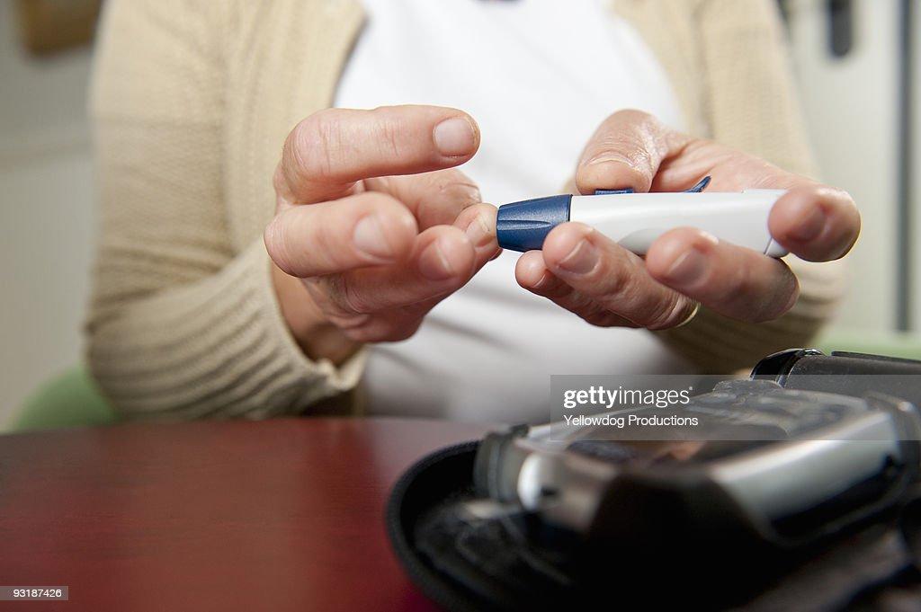 woman using diabetes test kit