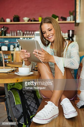 Woman using digital tablet in cafe : Stock Photo