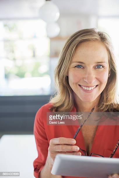 Woman using digital tablet indoors