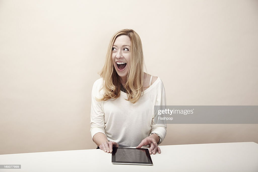 Woman using digital tablet : Stock Photo