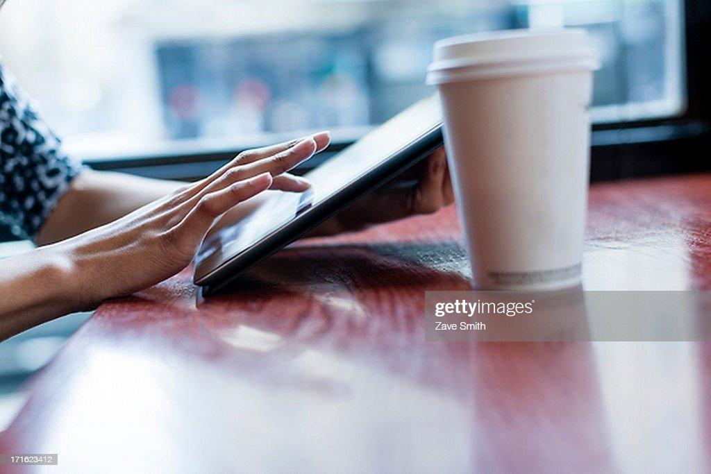 Woman using digital tablet : Stock Photo