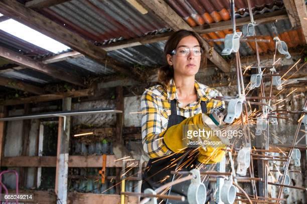 Woman using grinder in workshop