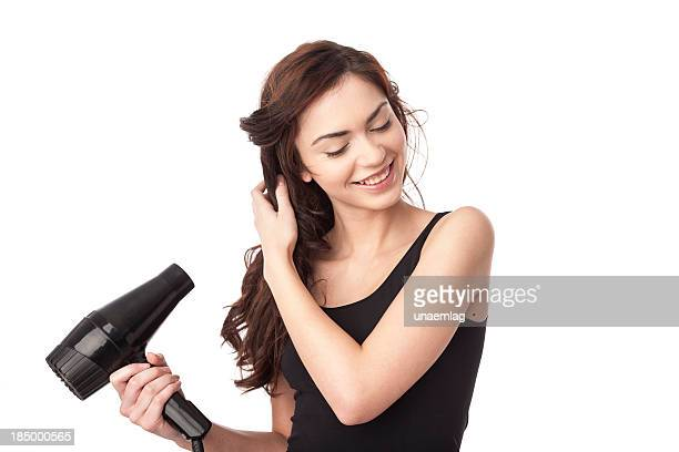 woman using hair drayer