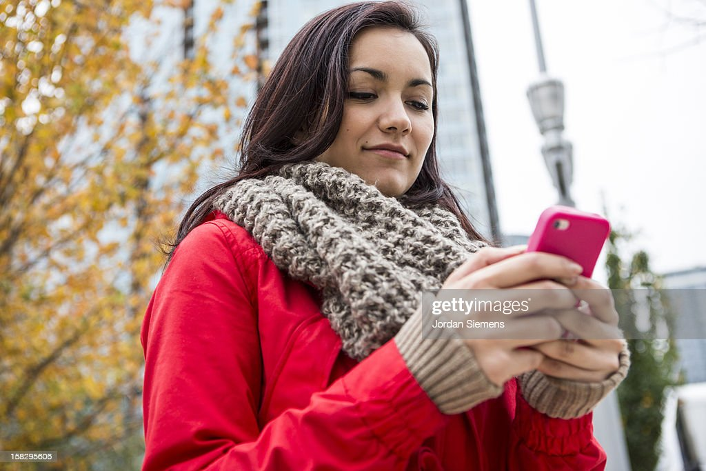 A woman using her cell phone. : Stock Photo