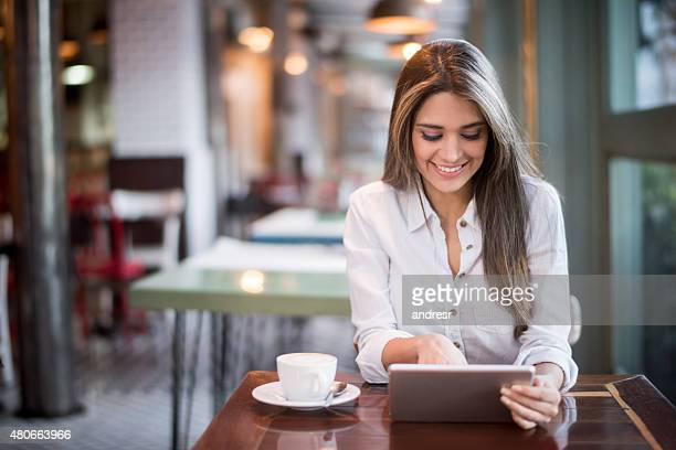 Woman using her tablet at a restaurant