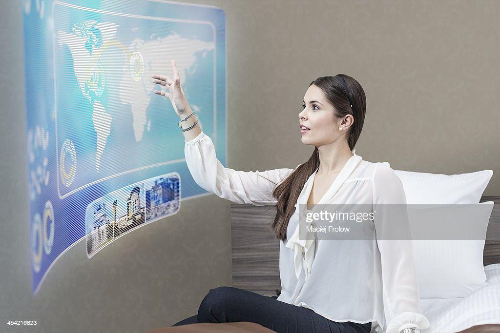 Woman using interactive screen