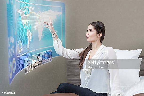Woman using interactive screen