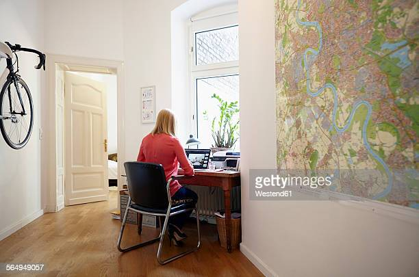 Woman using laptop at her home office