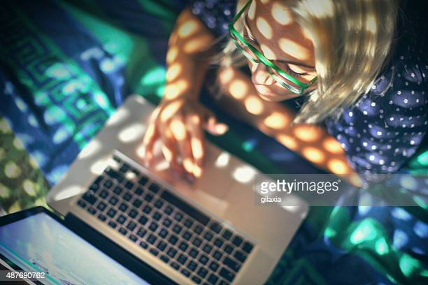 Woman using laptop at home.