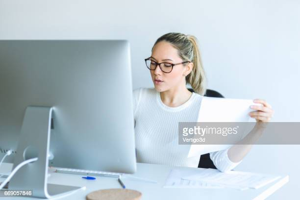 Woman using laptop at office