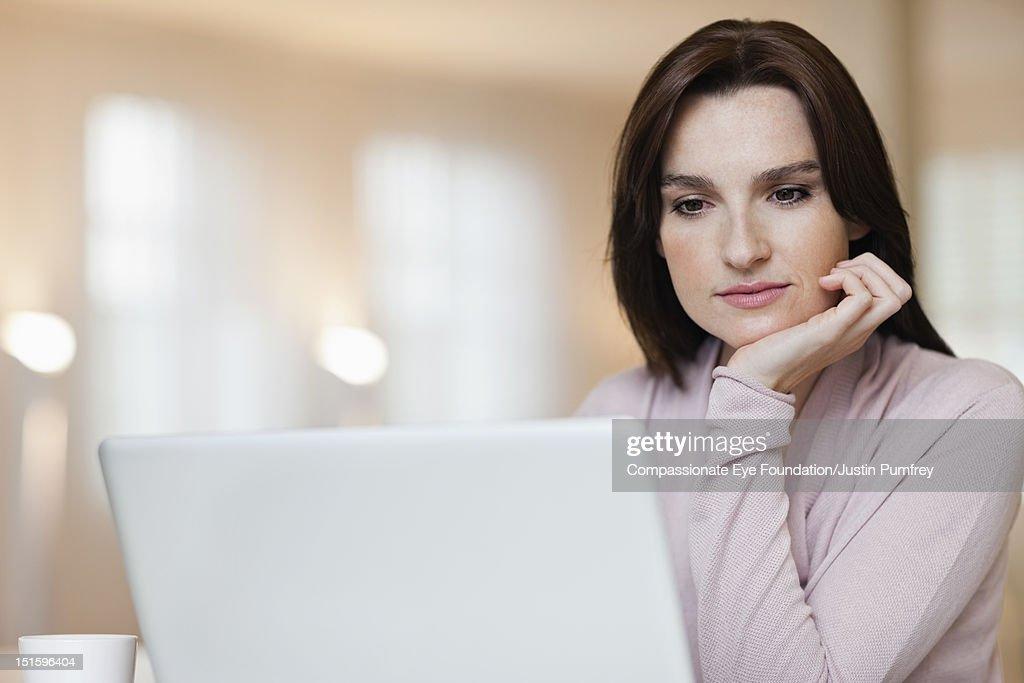 Woman using laptop, close up : Stock Photo